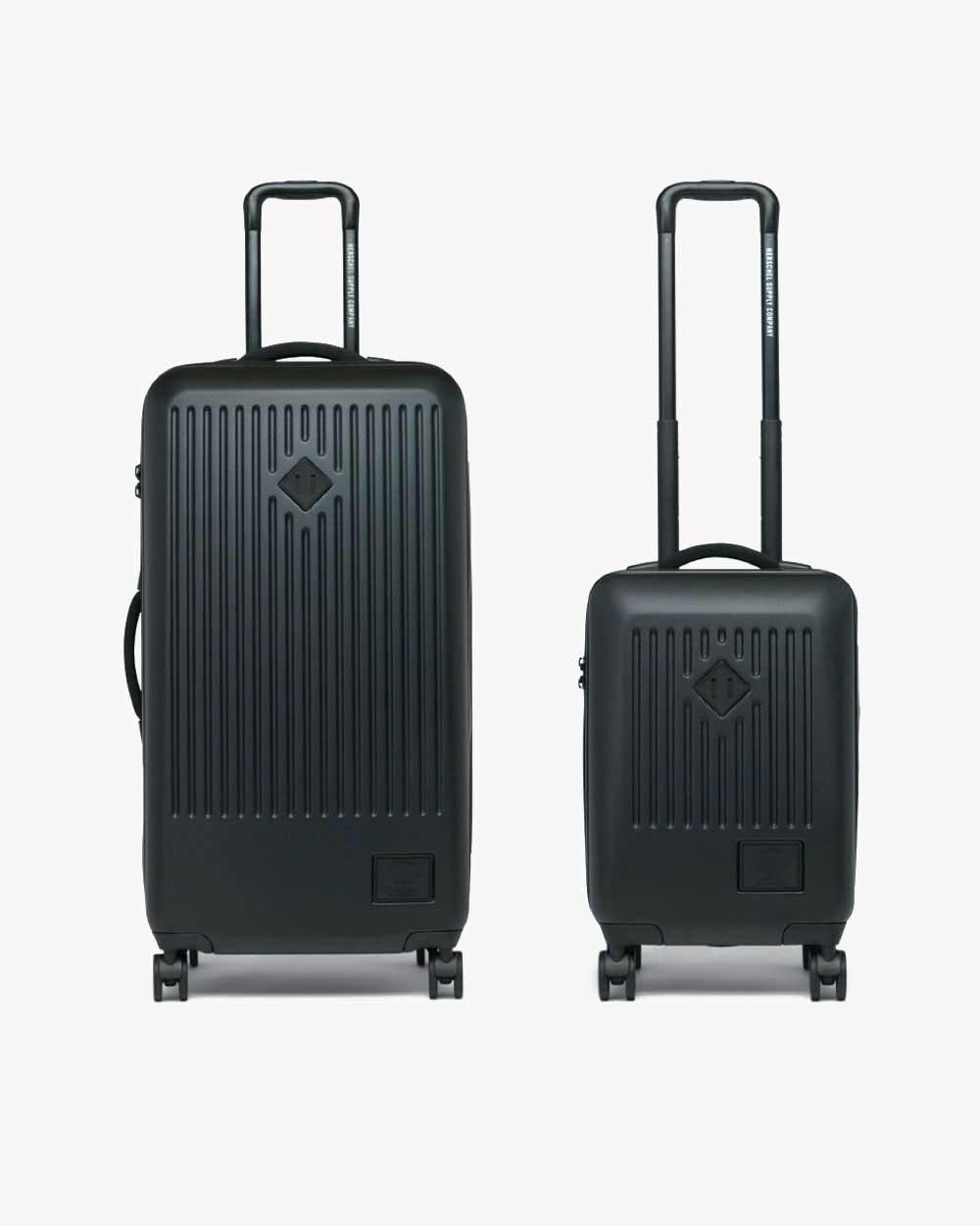 Bild eines schwarzen Herschel Trade Large Luggage und eines großen Trade Carry-Ons